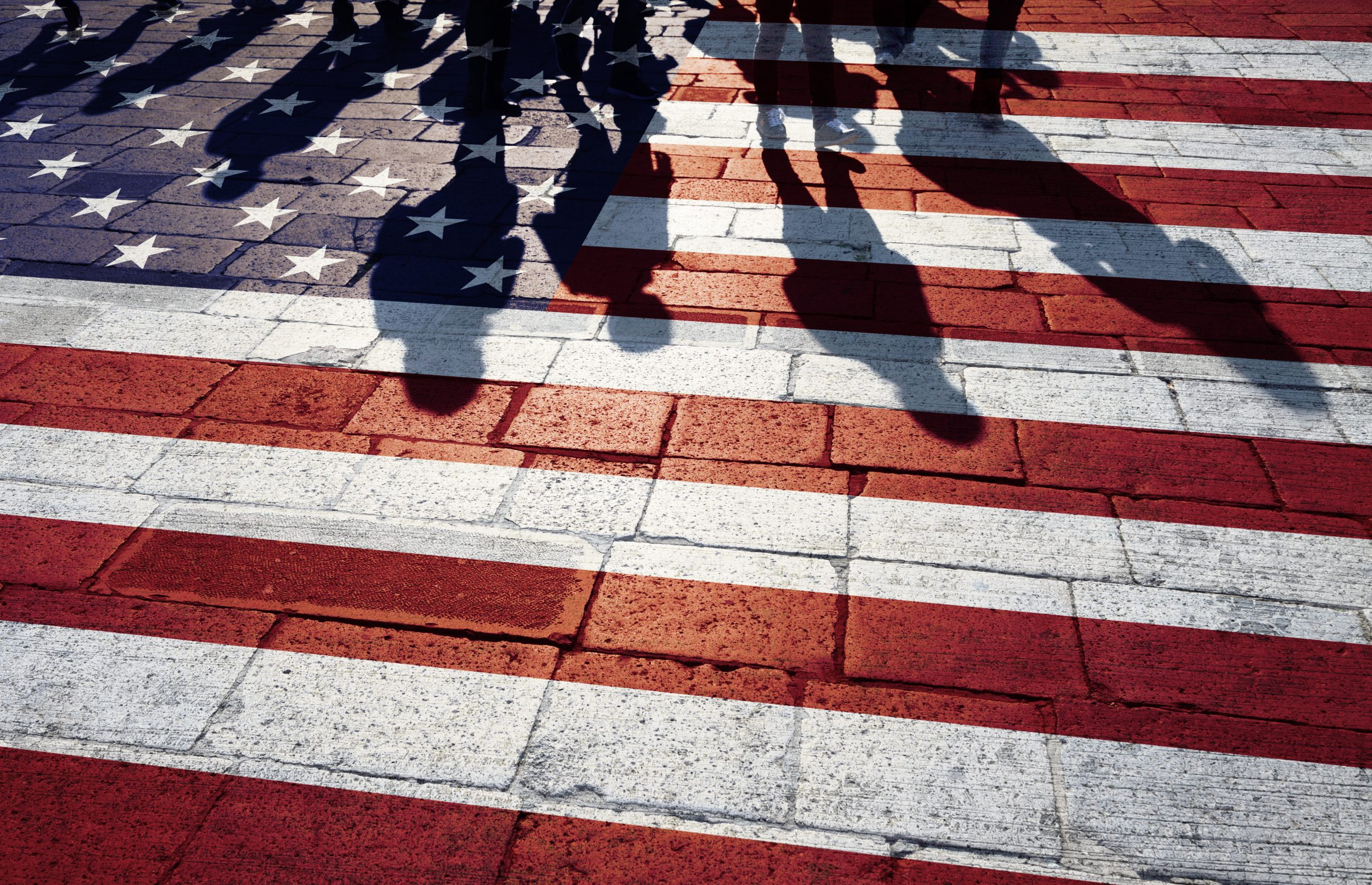 Tucson Immigration Lawyer American flag with immigrant shadows