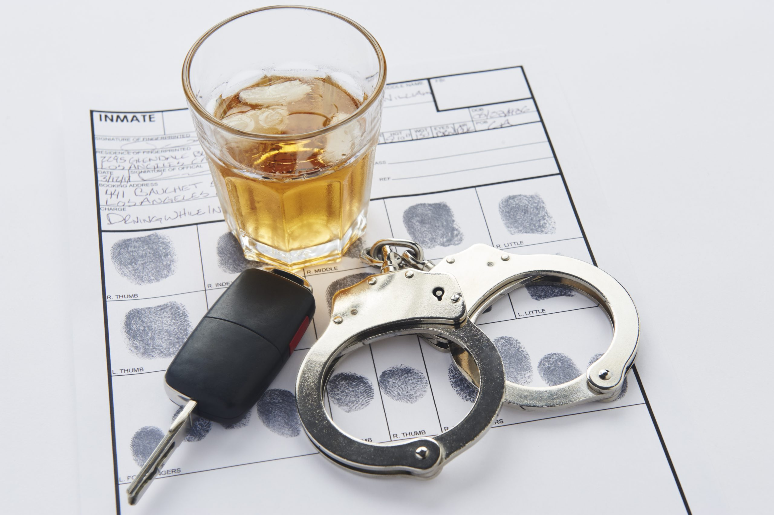 Phoenix DUI Defense Lawyer Alcohol, keys, and handcuffs placed on booking sheet