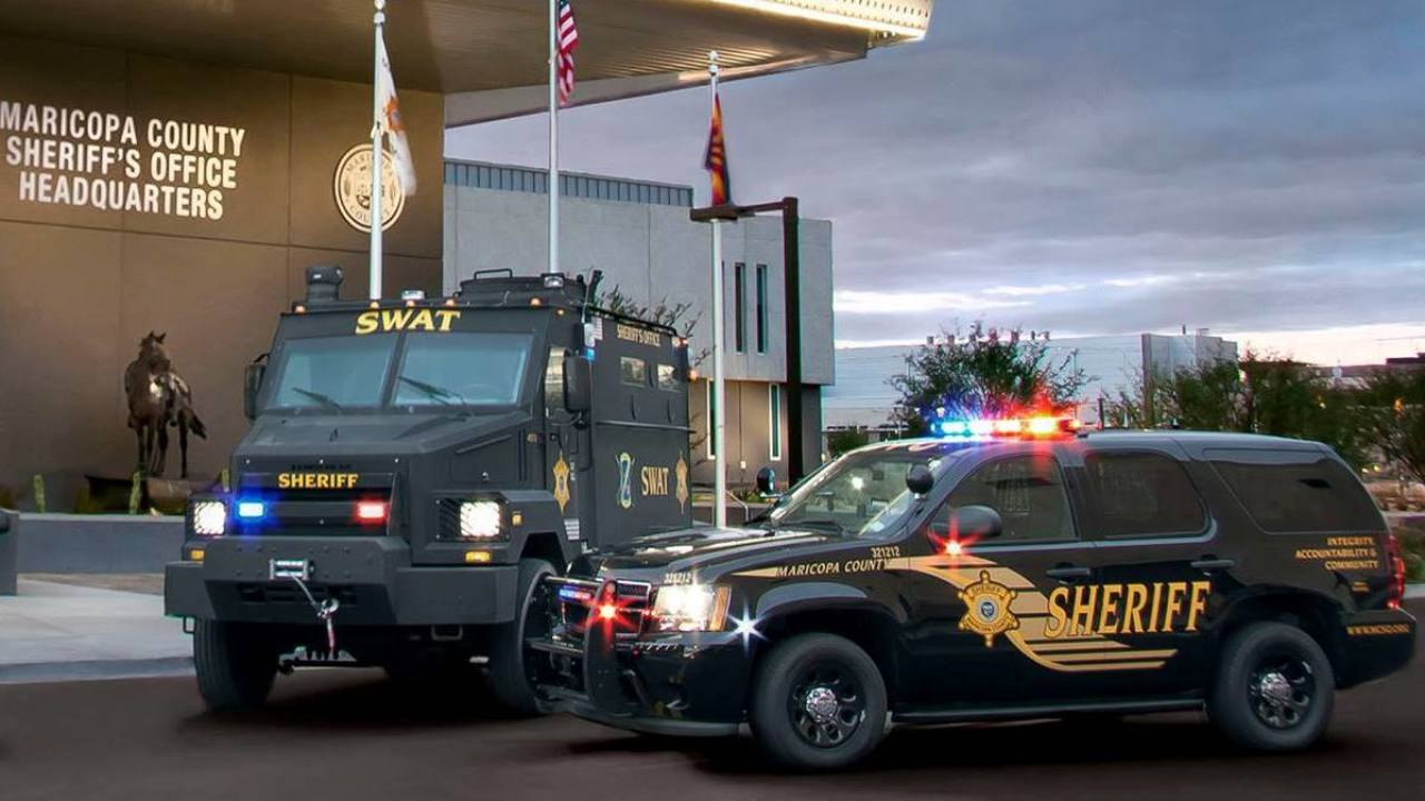 Maricopa County Drug Attorney - MCSO SWAT and patrol SUV outside Headquarters