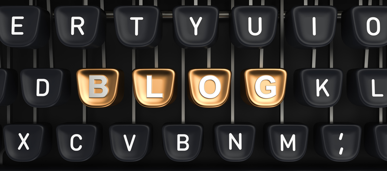 Blog - Typewriter with Gold keys spelling Blog